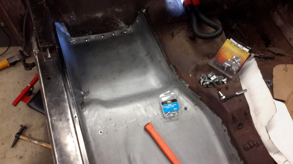 We're getting close!  We only need to weld in the new corner, drill out one rivet hole, and then begin the final installation. N.B. - Do not mount the rivets as shown in the photo; I was only using the rivets to position the floor pan.  The rivet head has to be on the fiberglass side!