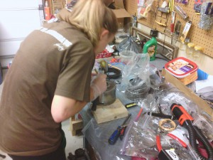 Jackie rebuilding the direct clutch.  Here she is driving out one of the bushing with a brass drift punch, getting ready for new bearings.
