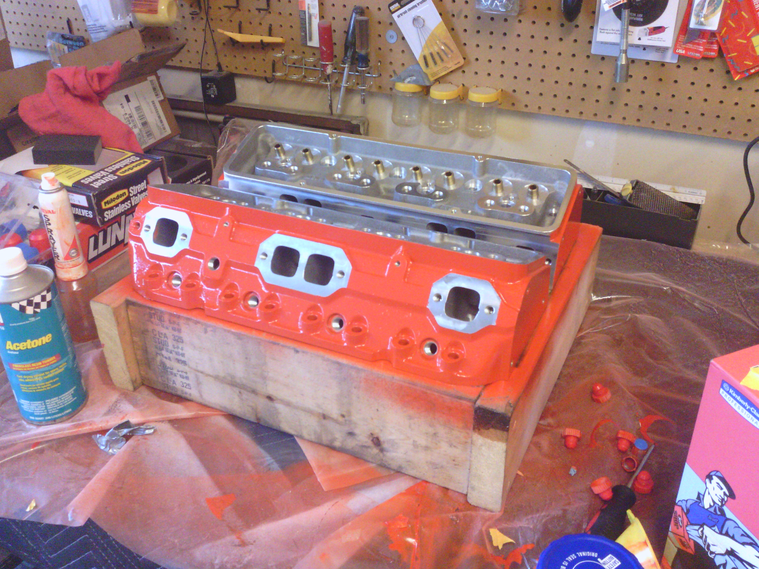 The new Dart  SHP cylinder heads in fresh Chevy engine orange paint.