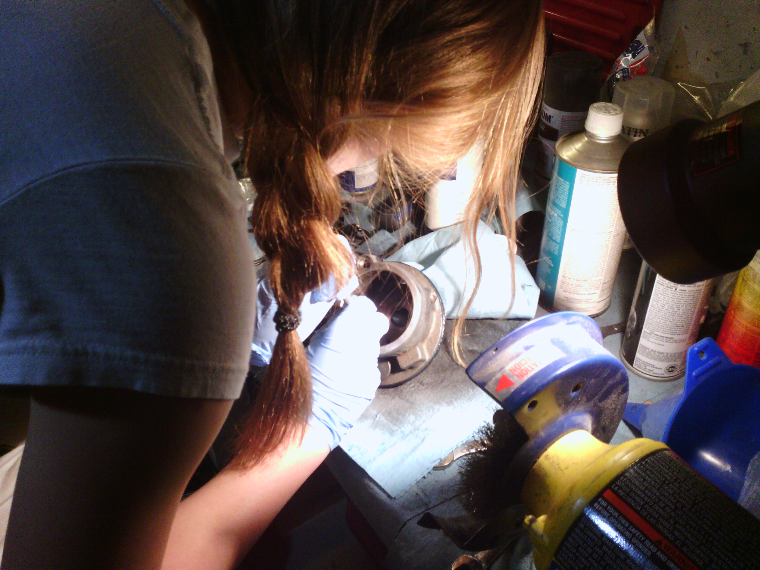 Jackie replacing the inner o-ring seals on the power steering pump.  The old o-rings were hardened and brittle and simply broke apart when being removed, which was not surprising since they were 38-years old!