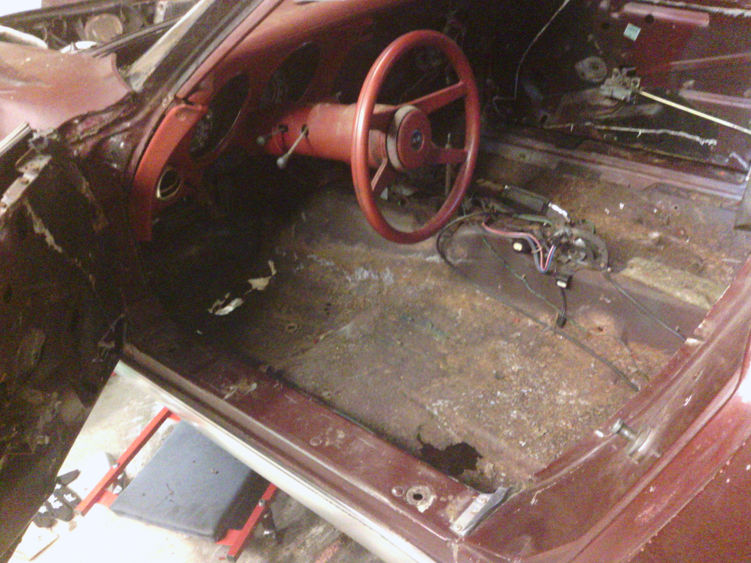 Only the instrument cluster, upper dash pad, A-pillars, and upper windshield trim remain.  Unfortunately many of the screws in the upper windshield trim and A-pillars are rusted solid and will need to be drilled out.
