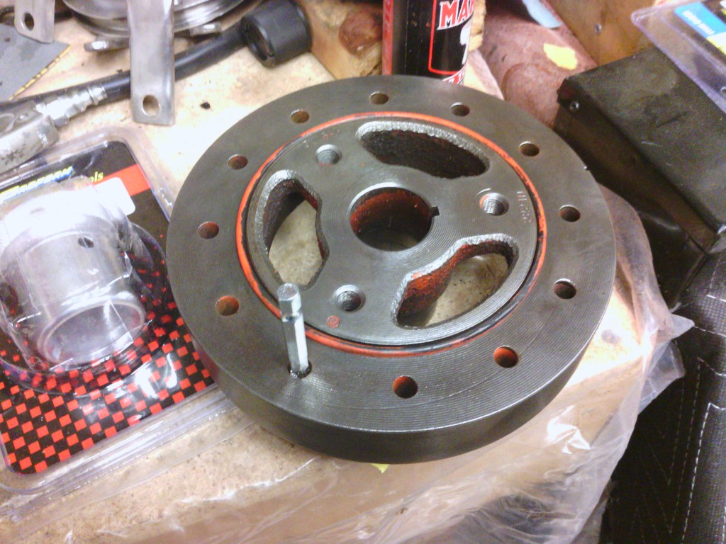 The harmonic balancer is cleaning up nicely, but it has a groove on the oil seal surface.  We'll have to add a repair sleeve to fix it, which we will do after it's painted Chevy engine orange.